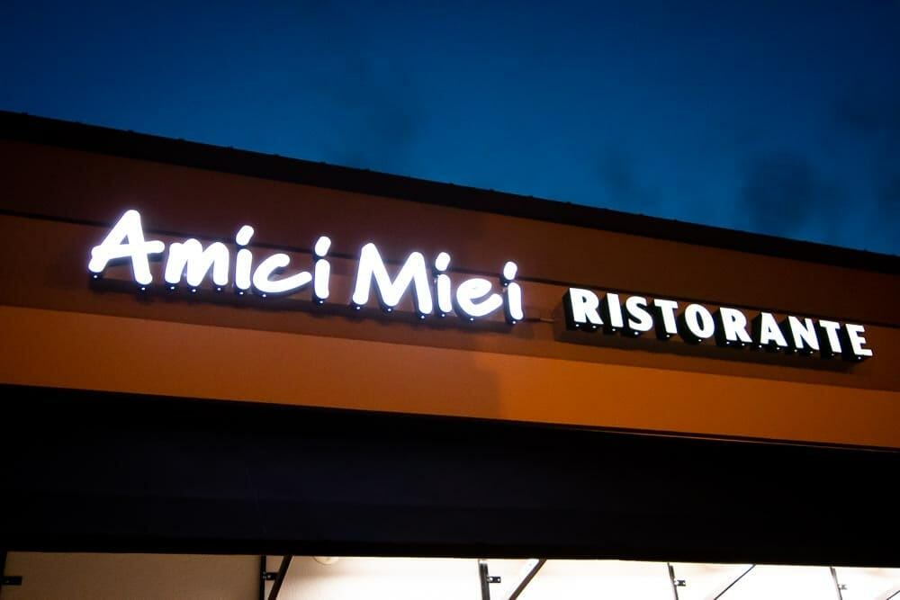 Night Shot of The Amici Miei Ristorante Sign