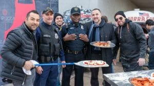 Marra Forni Brothers serve freshly cooked pepperoni and cheese pizza to Washington DC police officers