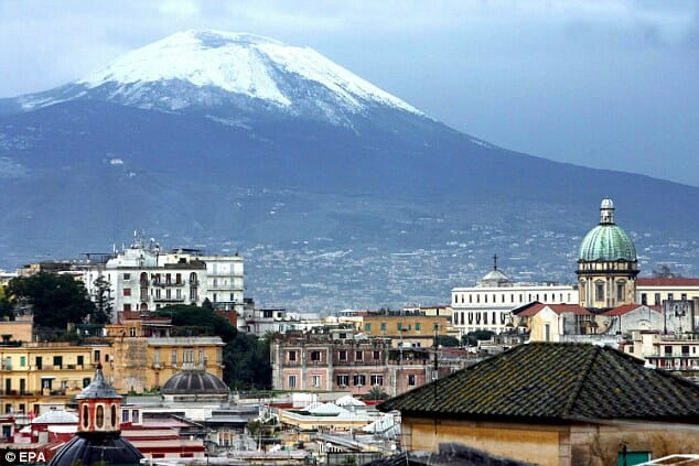 Mount Vesuvius overlooking the buildings in the city of Naples in Italy
