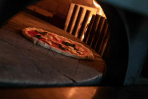 Margherita Pizza cooking in Marra FOrni Wood and Gas Fired Rotator OVen