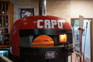 Marra Forni Wood and Gas Fired Rotator Oven with venting and Red tiles in La Posta Pizzeria