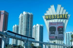 Marra Forni electric sign on westgate billboard for pizza expo in las vegas as train goes by in front