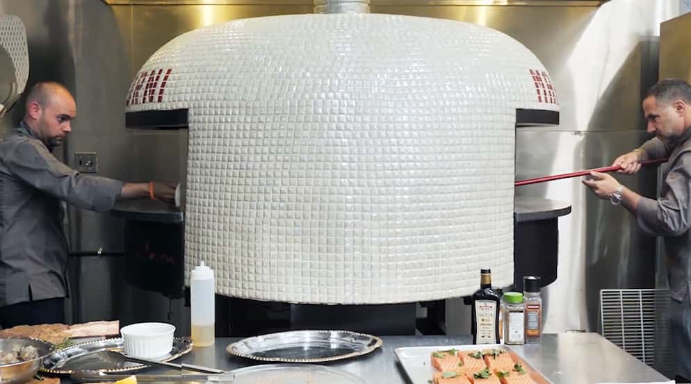 Two Chefs using Marra Forni Double Mouth Rotator White Tiled Oven cooking pizza