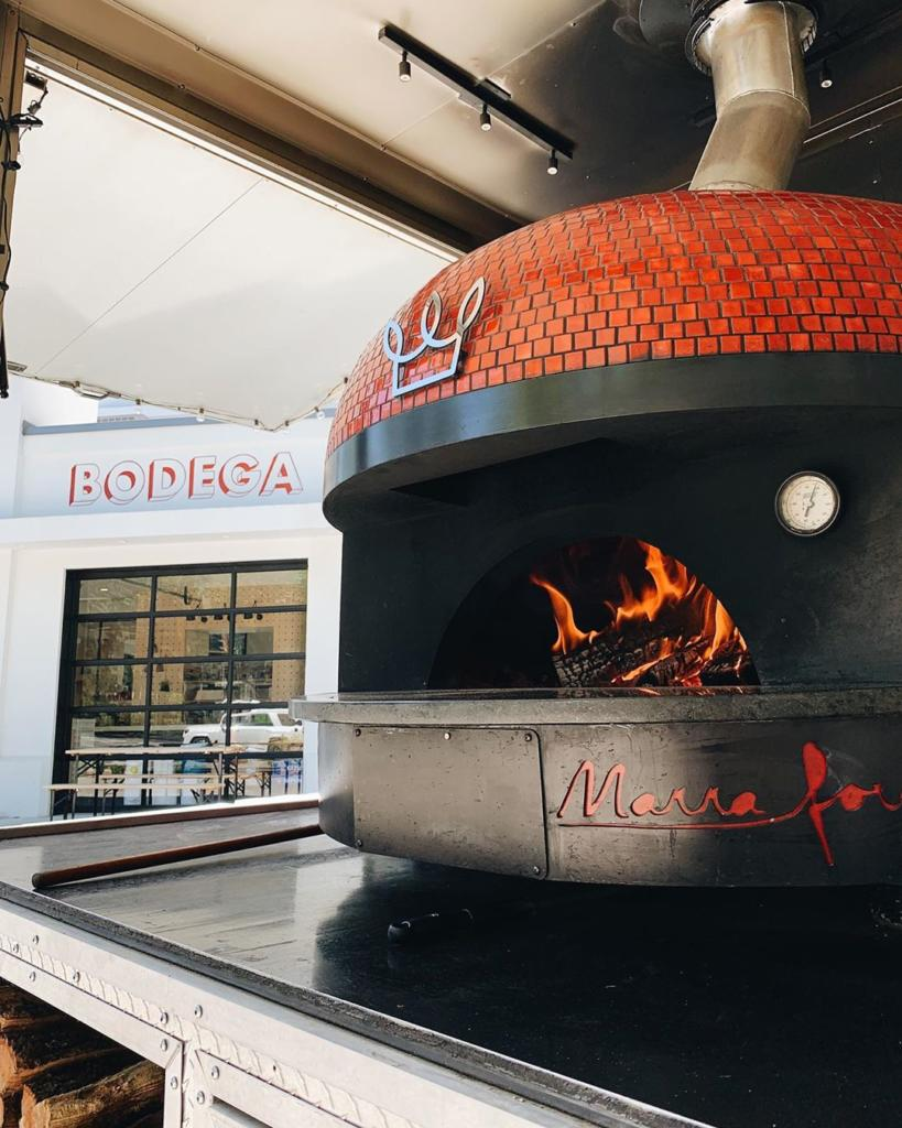Red mobile brick oven from Big Bon Pizza and Marra Forni oven