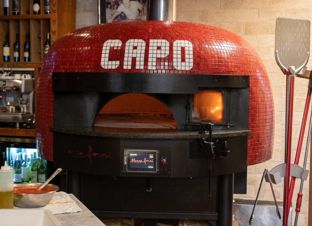 Red Tiled Brick Oven spelling out CAPO by Marra Forni