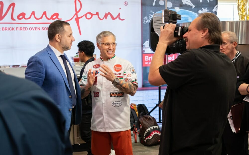 Italian brother at marra forni interviewed in front of camera at Pizza Expo 2019