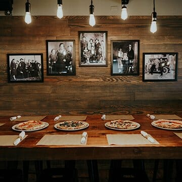 Four Pizzas lined up on dinner table in Moroso Wood Fired Pizzeria